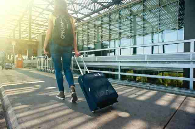 Female traveller with a suitcase